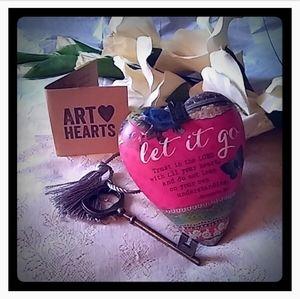"Retired ""Let It Go"" Art Heart Sculpture"